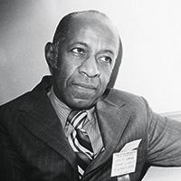 James Dumpson, black and white portrait in suit