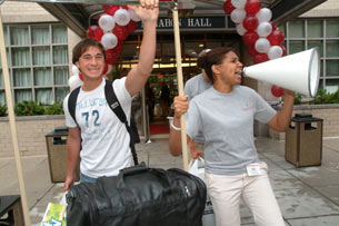 Orientation leader Tara Williams, FCLC '07, welcomes freshman Justin Stark (left) to the Lincoln Center campus. Photo by Chris Taggart