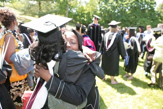 Congratulatory hugs were plentiful on graduation day at Marymount College. Photo by Peter Freed