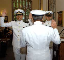 Midshipmen are sworn in at a commissioning ceremony at Duane Library. Photo by Ryan Brenizer