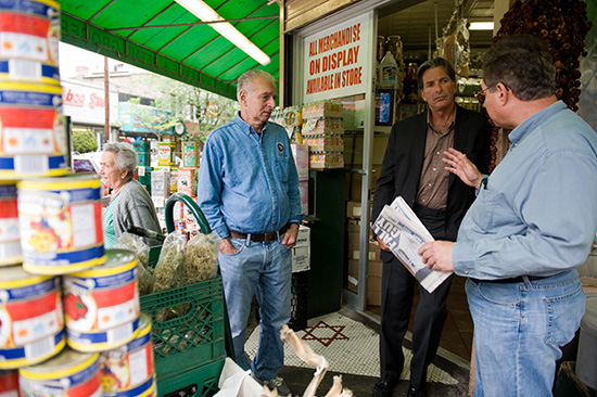 Frank Franz, FCRH '75 (right), president of the Belmont Small Business Association, talks with Madonia and Gil Teitel (left) outside Teitel Brothers grocery store, which was founded in 1915. Note the Star of David mosaic near the threshold. Gil Teitel's father, Jacob, installed the Jewish star outside the store during the Depression.