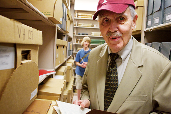 Bill Breisky and his grandson Ethan explore Hess' papers in the Fordham University Archives, 2011.
