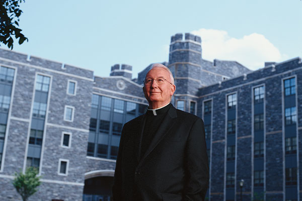 Fordham's 31st president stands in front of the student residence that will bear his name. O'Hare Hall —the Rose Hill building designed to enhance the interconnectedness of academic, residential, spiritual, and social life at Fordham—will be formally dedicated at a Homecoming ceremony this September.