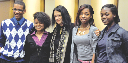 Cristo Rey students Randy Biagas-Hill and Hanielis Vargas, left, join Anne Waldman. To the right are Girls Write Now students Najaya Royal and Bre'ann Newsome. Photo by Janet Sassi