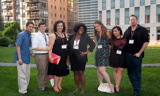 FCLC Reunion attendees pose against a backdrop of the newest addition to Fordham: the Law School building. (Photo by Jill LeVine)
