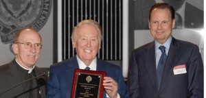 In January 2014, Nuñez (right) hosted a Fordham event on the set of Entertainment Tonight. He and Joseph M. McShane, SJ, president of Fordham (left), honored Vin Scully with the Ram of the Year award.