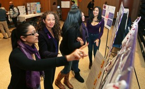 Students from researching domestic abuse wore purple, the color symbolizing awareness of the crisis.