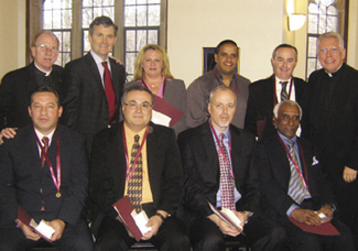 Seated, from left: Pjeter Cotaj, Gerardo Conte, Victor Birone and Winston Alexander.  Standing, from left: Joseph M. McShane, S.J., president of Fordham; Marco Valera, vice president for facilities management; Vera Zadrima, Jaime Sanchez, Noel Nevin and Monsignor Joseph G. Quinn, vice president for mission and ministry. Not pictured: Ismael Maldonado, Judy Porter, Luis Vargas  Photo by Thomas DeJulio