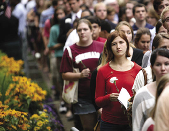 Students and other members of the Fordham community process from the University Church to the 9/11 memorial at Rose Hill.  Photo by Michael Dames