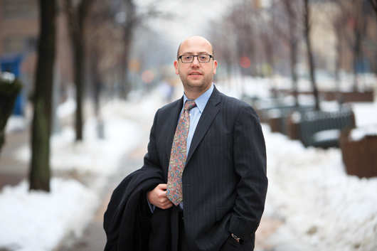Jay Savage, Ph.D., GSAS '11, found his niche at Yeshiva University as director of academic information technology. Photo by Tom Stoelker