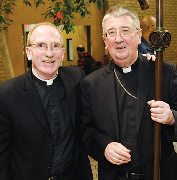 Joseph M. McShane, S.J., president of Fordham (left),  welcomed Archbishop Martin to the Lincoln Center campus.  Photo by Leo Sorel