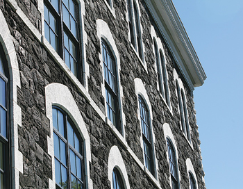 Detail of the freshly restored stonework and cornice. Photo by Tom Stoelker
