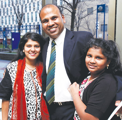 Paul Thyagaraj, manager of custodial services and facilities management, with his wife, Tryphosa (left), and daughter, Tayphath, after receiving his Sursum Corda award at the 2013 University Convocation on March 3. Photo by Bruce Gilbert