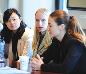 Fordham graduate students Xiaoming Liu and Amie Senland, and Kate Palmer, executive director of the Global and Regional Asperger Syndrome Partnership, speaking at Fordham's conference on autism. Photo by Chris Taggart