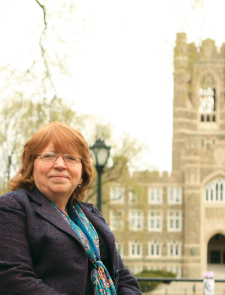 """Margaret """"Margie"""" Ball oversees commencement preparation at Fordham. Photo by Photo by Tom Stoelker"""