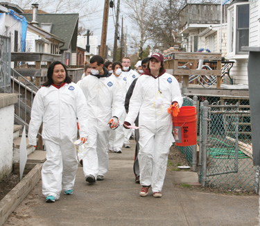 Fordham volunteers came out on Jan. 11 to help clean up the remnants of Hurricane Sandy in Breezy Point, Queens.  Photo by Bruce Gilbert