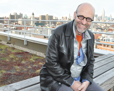 Colin Cathcart takes in the view on the roof deck of The Lee, a LEED Gold residence for the formerly homeless on the Lower East Side. Photo by Patrick Verel