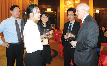 GBA Dean David Gautschi, right, meets with GBA alumni and friends at a reunion in Beijing on Dec. 2. More than 120 GBA alumni and friends attended a banquet and celebation.  Contributed photo
