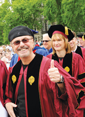 Dion DiMucci, left, and Patricia E. Harris, right, honorary degree recipients, march in the commencement procession.  Photo by Chris Taggart