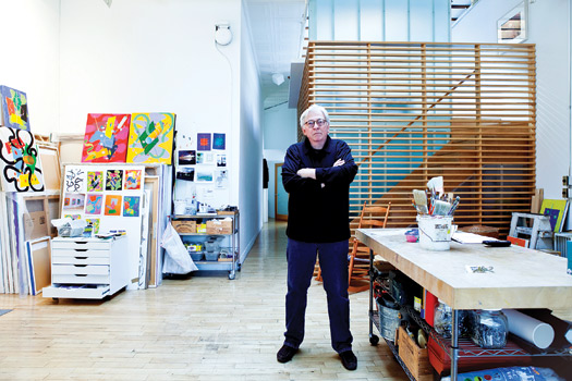 William Conlon, pictured in his Soho studio, aims to tap into viewers' subconscious with his art. In the background are pieces from his Collider series. Photo by Gerald Foster