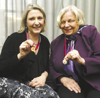 Eva Patton, left, and Joan Roberts, Ph.D., right, both Lincoln Center campus awardees, proudly show their medals.  Photo by Bruce Gilbert