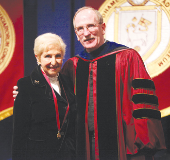 Joseph M. McShane, S.J. president of Fordham, presents Margot Nadien, Ph.D., with the Bene Merenti medal for 40 years of service to the University. Photo by Bruce Gilbert
