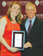 Abigail Corning with Charlie Elwood, deputy director of athletics. Photo by Vincent Dusovic