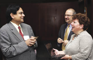 """W. """"RP"""" Raghupathi, Ph.D. (left), professor of information systems and director of the Center for Digital Transformation, welcomes keynote speaker Karen Parrish. Photo by Bruce Gilbert"""