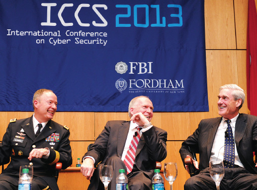 Three of the nation's chiefs of security appeared together publicly for the first time on Aug. 8 at the fourth ICCS conference, sponsored by Fordham and the FBI. From left to right are NSA head Gen. Keith Alexander, CIA head John Brennan, FCRH '77, and outgoing FBI head Robert Mueller.  Photo by Chris Taggart