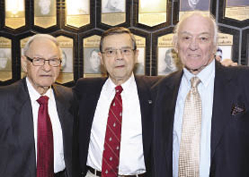 Andy Lukac (FCRH '51), Dave Ficca (GSB '53) and Tom Dolan (FCRH '51) were members of the 1949 Fordham football team. Photo by Chris Taggart