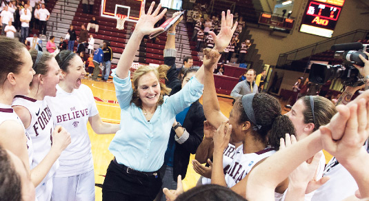 Stephanie Gaitley, women's basketball coach, gets enthusiastic with her team at a playoff game held this spring. The Lady Rams had the best basketball season in more than 30 years. . Photo by Mitchell Leff