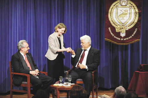 GSAS Dean Nancy Busch, center, presents Kamal Y. Azari, Ph.D., GSAS '88, with a GSAS crystal insignia. To the left is Azari's Fordham mentor, John Entelis, Ph.D., professor of political science and director of the Middle East Studies Program.  Photo by Chris Taggart