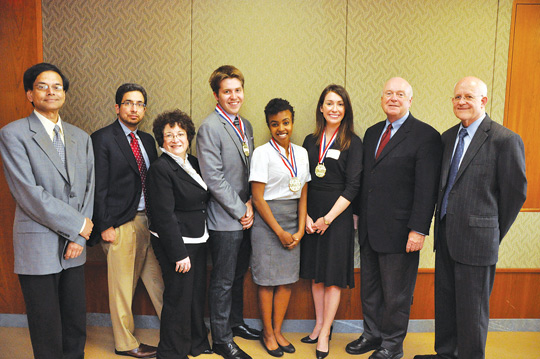 """From left to right: """"RP"""" Raghupathi, Ph.D., professor of information systems, Philip M. Napoli, Ph.D., professor of communication and media management, Marcia H. Flicker, Ph.D., associate professor of marketing, Andrew Adams, Nyambura Mbugua, Meghan Barquinero, Peter Johnson, Ph.D., lecturer of marketing and David A. Gautschi, Ph.D., dean of GBA. Photo by Patrick Verel"""