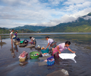 Workers wash Social Fabric shirts in Guatemala's famed Lake Atitlan. Photo by Greg Lord
