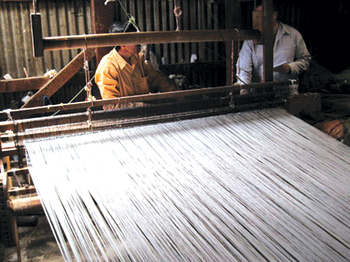 In a small village near Solola, Guatemalan villagers weave the fabric on a hand loom. Photo by Greg Lord