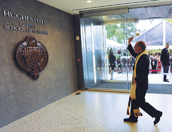 Father McShane blesses Fordham's newest building with holy water Photo by Chris Taggart