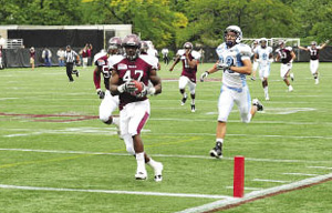 Scenes from Homecoming 2011: Students cheer for Fordham; a Ram runs for a touchdown; old friends reunite.  Photos by Chris Taggart