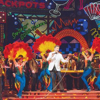 Christine Jones' set for the Met's Rigoletto brings Las Vegas neon to Verdi's Mantua. Photo courtesy Metropolitan Opera