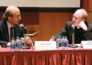 Joel Klein and Father McShane discuss blending tech and curriculum.  Photo by Ye Yuan