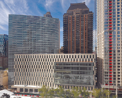The new law school building, center, as seen from Lincoln Center for the Performing Arts.