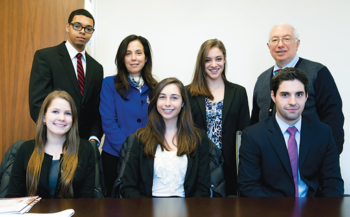 Standing, left to right: Adam McWilliams; Donna Rapaccioli, Ph.D., dean of the Gabelli School of Business; Madeline Danza; Al Greco, Ed.D., professor of marketing. Seated, left to right: Alexandra Jameson; Alexa Gavin; Michael Artiles. All students are members of the Gabelli Class of 2014.  Photo by Dana Maxson