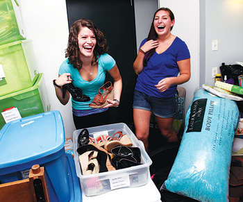 New roommates Noelle Starr and Lauren Lopez show off a few of their favorite things in their room at Martyrs' Court. Photo by Bruce Gilbert