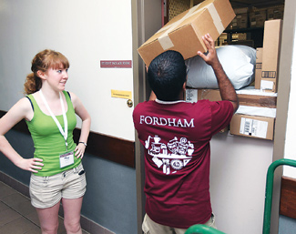 Oregon resident May McCallum gets a little help at the Lincoln Center campus post office, where her things arrived via mail.  Photo by Michael Dames