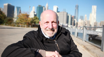 Roger Panetta studies the past and present of the Brooklyn waterfront.  Photo by Tom Stoelker