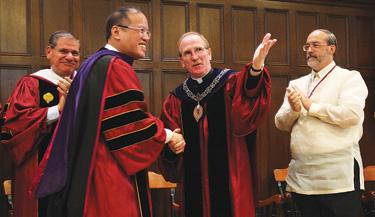 Benigno Aquino shakes the hand of Joseph M. McShane, S.J., president of Fordham.  Photo by Bruce Gilbert