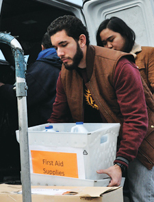 Michael Martinez, FCRH '13, was on the front lines collecting items for donations last November, and was a frequent volunteer Photo by Joanna Klimaski