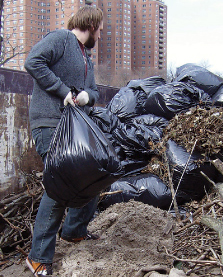 Dan Mullen helped clear dead tree roots on a spring volunteer trip to Brighton Beach.