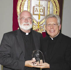 Gregory Boyle, S.J. (left), poses with Monsignor Joseph G. Quinn, S.J., vice president of University mission and ministry.    Photo by Ken Levinson