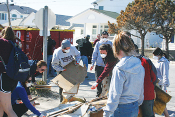 Football student-athletes move drywall for Sandy victims