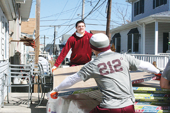 Fordham student-athletes help clear debris.